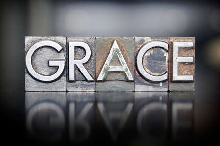 The word GRACE written in vintage letterpress lead type Imagens