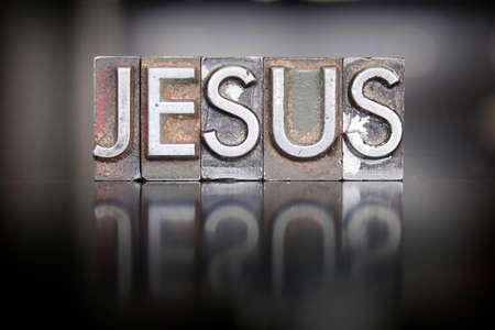 crucify: The name JESUS written in vintage lead letterpress type Stock Photo