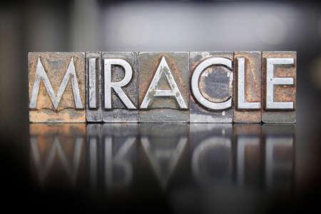 The word MIRACLE written in vintage lead letterpress type photo
