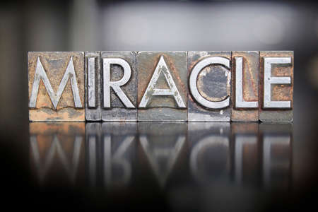 The word MIRACLE written in vintage lead letterpress type Stok Fotoğraf