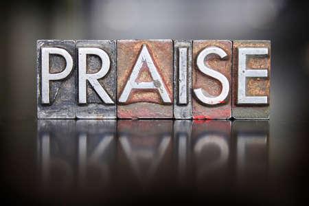 praising: The word PRAISE written in vintage lead letterpress type