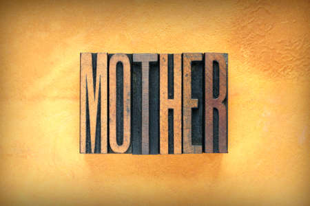 The word MOTHER written in vintage letterpress type