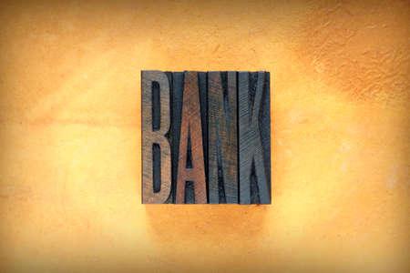 credit union: The word BANK written in vintage letterpress type