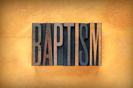 baptize: The word BAPTISM written in vintage lead letterpress type Stock Photo