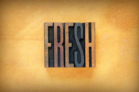 The word FRESH written in vintage letterpress type 版權商用圖片