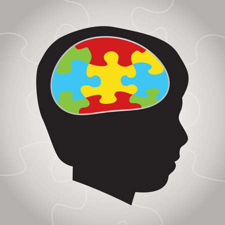 A silhouette of a child with symbolic autism puzzle pieces making the brain space. Vector EPS 10 available. Vector