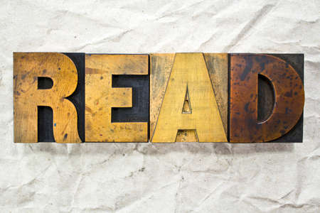 The word READ written in vintage letterpress type