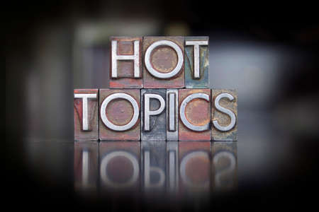 the topics: The words Hot Topics written in vintage letterpress type Stock Photo
