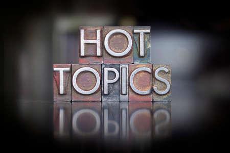 letterpress  type: The words Hot Topics written in vintage letterpress type Stock Photo