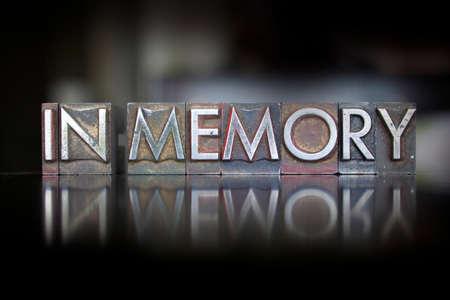 The words In Memory written in vintage letterpress type Foto de archivo