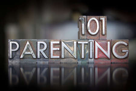 The words Parenting 101 written in vintage letterpress type Stock Photo