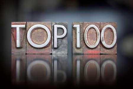 The words Top 100 written in vintage letterpress type 스톡 콘텐츠