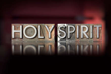 The words Holy Spirit written in vintage letterpress type