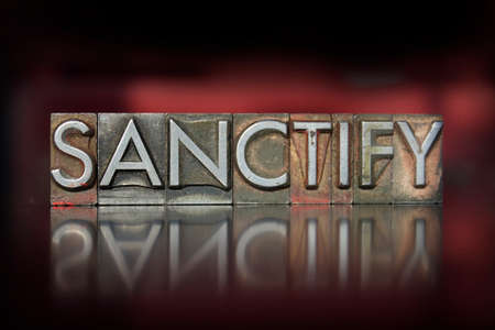 sanctification: The word Sanctify written in vintage letterpress type Stock Photo
