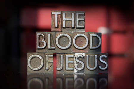 The words The Blood of Jesus written in vintage letterpress type photo