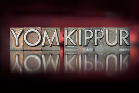 The holiday Yom Kippur written in vintage letterpress type photo