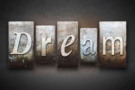 Het woord DREAM geschreven in vintage boekdruk type Stockfoto