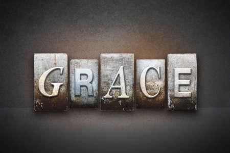 The word GRACE written in vintage letterpress type Foto de archivo
