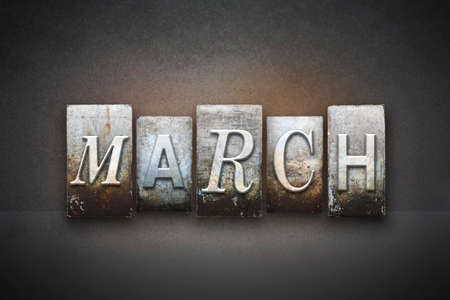 The month MARCH written in vintage letterpress type photo