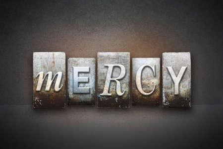 Het woord MERCY geschreven in vintage boekdruk type Stockfoto