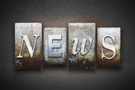 The word NEWS written in vintage letterpress type photo