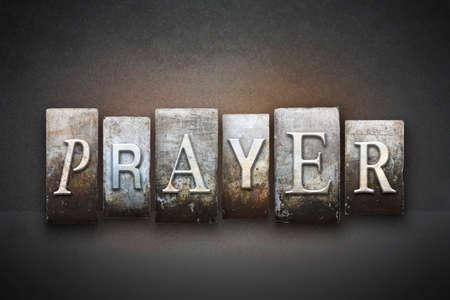 ビンテージ活版型で書かれた祈りの言葉 写真素材