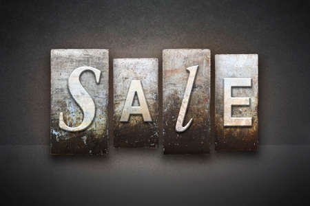 The word SALE written in vintage letterpress type photo