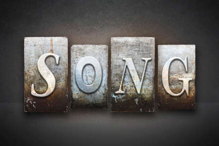 lullaby: The word SONG written in vintage letterpress type Stock Photo