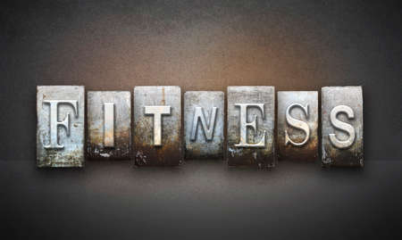 The word FITNESS written in vintage letterpress type photo