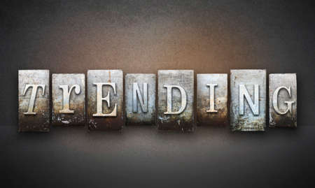 trending: The word TRENDING written in vintage letterpress type Stock Photo