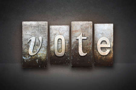 voting booth: The word VOTE written in vintage letterpress type Stock Photo