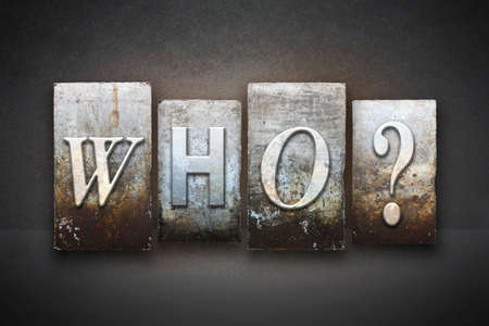 The word WHO? written in vintage letterpress type photo