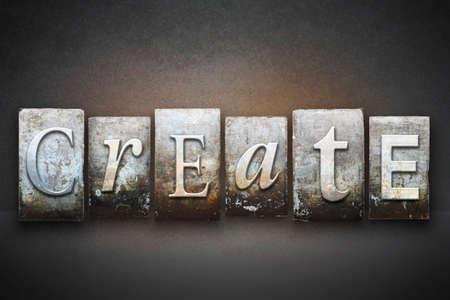 The word CREATE written in vintage letterpress type Фото со стока