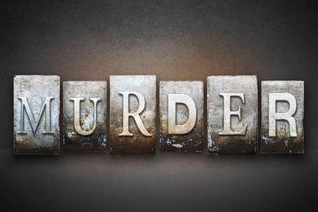 The word MURDER written in vintage letterpress type photo
