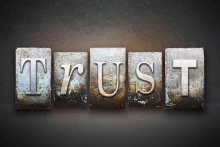 The word TRUST written in vintage letterpress type