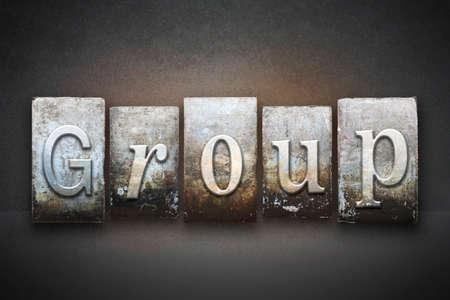 The word GROUP written in vintage letterpress type