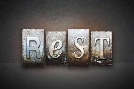 sleep: The word REST written in vintage letterpress type
