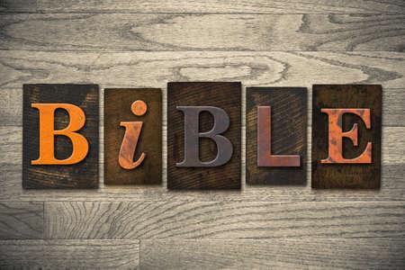 The word BIBLE written in wooden letterpress type.