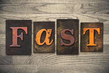 The word FAST written in wooden letterpress type.