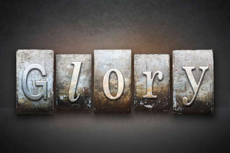 adoration: The word GLORY written in vintage letterpress type Stock Photo