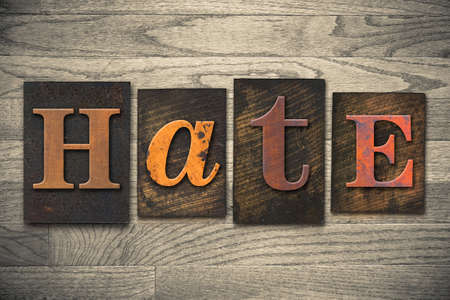 abomination: The word HATE written in wooden letterpress type. Stock Photo