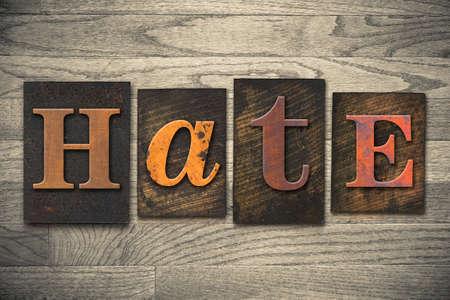 The word HATE written in wooden letterpress type. Stock Photo