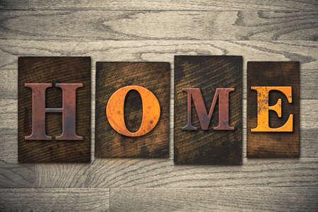 letterpress letters: The word HOME written in wooden letterpress type.