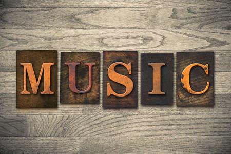 hymn: The word MUSIC written in wooden letterpress type.