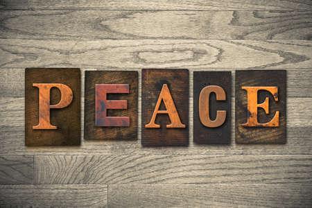 ceasefire: The word PEACE written in wooden letterpress type.
