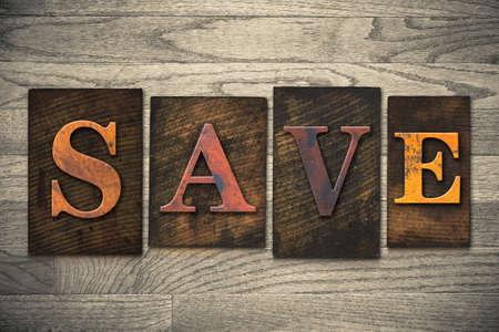 """Het woord """"SAVE"""" geschreven in houten boekdruk type. Stockfoto"""