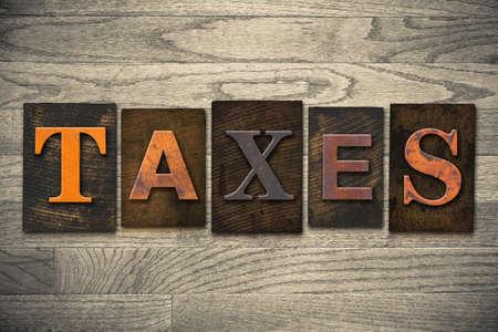 The word TAXES written in wooden letterpress type.