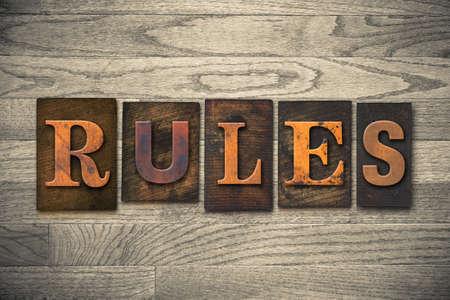 letterpress: The word RULES written in wooden letterpress type. Stock Photo