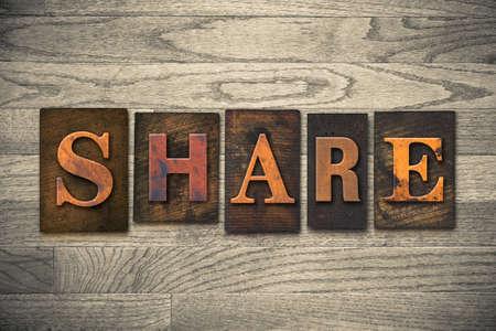 The word SHARE written in wooden letterpress type.