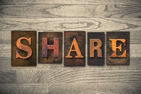 shared sharing: The word SHARE written in wooden letterpress type.